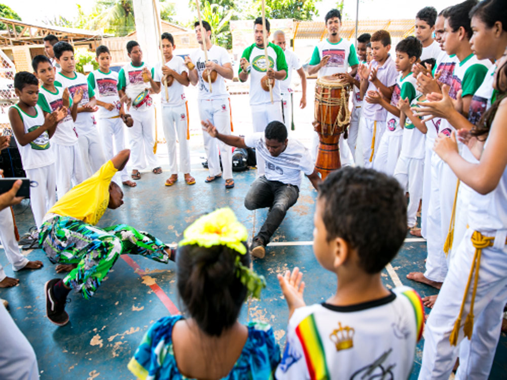 What is the Capoeira Batizado ceremony?